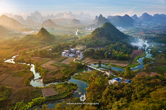 Guilin Mountain Retreat (fesign) Tags: asia beautyinnature boat chinaeastasia cloudsky colourimage day dusk eastasia elevatedview evening field guangxizhuangautonomousregionchina guilin hill horizontal house humansettlement karstmountains lake landfeature locallandmark mountain mountainrange mountainretreat nature naturereserve nopeople outdoors photography reflection river riverli rollinglandscape ruralscene scenics sky skyline sunlight sunset sunsetdawn touristresort tranquilscene travel traveldestinations water xinping yangshuo