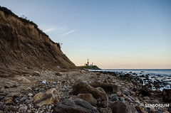 Montauk Light from the rocky beach (SensoriumStudios) Tags: new york light lighthouse house ny point island amazing long breath towers taken hike montauk taking