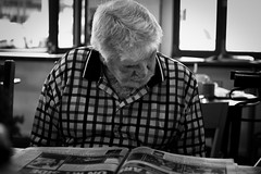 Pa in Millthorpe (pnarsiman) Tags: grandparents grandpa grandma grandmother grandfather old people black white bw nikon d5300 35mm australia cafe reading newspaper magazine