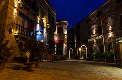 Behramkale Assos ,Turkey - January 01, 2017 : Kervansaray hotel at night (yuliakupeli) Tags: greece acropolis aegean ancient archeology architecture assos athena behramkale blue boat building cafe canakkale civilization classical cloud culture day europe famous fishing golden greek harbor historical history hotel house iskele landmark landscape marble mediterranean monument old outdoors past place port roman ruined ruins scene sea sky stone summer sunset temple tourism traditional travel turkey vacation village wall water