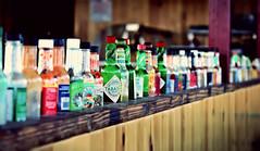 tabasco (Rino Alessandrini) Tags: scelta prospettiva indecisione bottiglie colori vetro salse sfocato fila choice perspective indecision bottles color glass sauces blurred row tabasco jalapeno