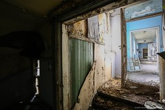 Behind The Facade (john&mairi) Tags: derelict abandoned deserted disused asylum victorian hospital mental health glasgow scotland urbex corridor passage door debris rotting neglected