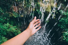 Nothings out of reach. (mozaackroyd) Tags: nature water waterfall droplets scenery hand view waterfalls droplet greenery