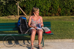 Paris June 2015 (7) 208 - Saturday night at the Eiffel Tower - Jayne waiting for me....to buy her a drink I think (Mark Schofield @ JB Schofield) Tags: street people woman paris france tower bench french reading ride legs roundabout saturday carousel eiffel shorts sat stgermain