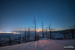 Moment of Moonrise (kevin-palmer) Tags: bighorn sheridan bighornnationalforest bighornmountains january winter snow snowy evening irix15mmf24 blue sky night stars starry astronomy astrophotography snowshoeing moon moonrise shadows orange burnt trees lights nikond750