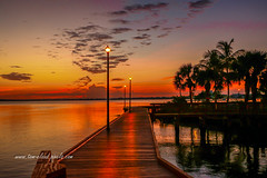 Boardwalk Sunrise (tclaud2002) Tags: sun sunrise sky dawn morning clouds cloudy river stlucieriver water waterfront lamp lmappost boardwalk palms plamtree tropicaloutdoors outside nature mothernature stuart florida usa