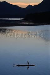 30100779 (wolfgangkaehler) Tags: 2017 asia asian southeastasia laos laotian luangprabang centrallaos town unescoworldheritagesite mekongriver mekong sunset fisherman water boat silhouette silhouetted fishing fishingnet