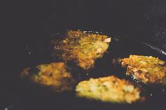 Zucchini fritters frying in a cast iron pan (laralfield) Tags: summer food macro recipe photography smoke vegitarian castiron zucchini fried fritters grapeseed laralittlefield