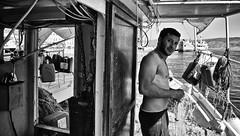 Sur les traces du père, jeune pêcheur de retour de mer qui nettoie ses filets un dimanche matin à #Hydra #Grèce (nikosaliagas) Tags: mer fisherman greece pêcheur grèce hydra