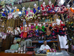 Businesses in Myanmar (Asian Development Bank) Tags: old people toys dolls locals yangon markets goods puppets elderly shops myanmar merchandise products elders stores handicrafts trade economics mmr stalls seniors citizens vendors shopkeepers smallbusiness storekeepers livelihood salespersons