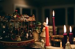 Christmastime (tarkushoo) Tags: film 135 candles carousel merrygoround advent candle dof candlelight nikon fe2 figurines