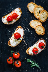 Roasted tomato and ricotta bruschettas (Arx0nt.) Tags: closeup italian vegetarian meal pepper natural delicious green overhead red diet snack canape breakfast olive blackboard old garlic gourmet wine black roasted vertical toast rosemary vegetable tomato cherry tasty healthy dried ricotta lunch cheese sandwich above appetizer fresh bread oil baguette food cottage bruschetta crostini ciabatta cottagecheese italiancuisine topview