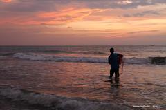 Net fisherman looks into the sunset - Negombo Sri Lanka (WanderingPhotosPJB) Tags: img sunsets srilanka negombo clouds sky fisherman net