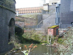 Manchester - Green Quarter river (rossendale2016) Tags: riverside small utility building shed sewerage sewage arch workers brickwork railings archway arches architecture edwardian victorian rundown down run old new area derelict isolated footpath handrail stone wall climb climbing climbed ladder steps road bridge outfall upcoming water pipe river quarter green manchester