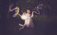 Releasing the magic... (Wojtek Piatek) Tags: wood pink portrait girl sparkles forest dark child dress magic fairy glowing lantern dust portret magical spark enchanted zeiss135 sonya99