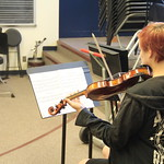 Student playing violin.