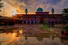 Go in peace (Fortunes2011.) Tags: sunset architecture sky clouds reflection mosque masjid placeofworship weather rain water sun dome minarets khairulamal ancholi karachi