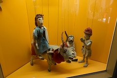 Marionettes ride a bull