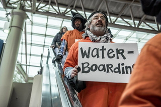 Brian Terrell Holds a Sign During an Anti-Torture Demonstration at Union Station