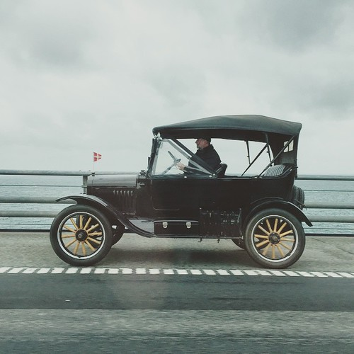 Please forgive the quality of the photo, it was taken through the window of a car, driving at around 120 km/h, on a windy bridge, where this delightful antique car was driving in the emergency lane (due to its low top speed, there was thankfully nothing w