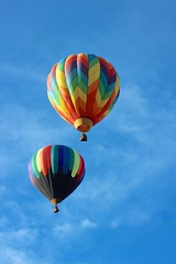 Two balloons drifting over California (Karol Franks) Tags: above sky hot color vertical balloons fun flying colorful sailing peace escape ride bright air flight adventure flame liftoff midair soaring temecula ballooning uplifting drifitng roomfortext