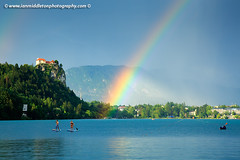 Rainbow over Lake Bled (Ian Middleton: Photography) Tags: travel summer vacation mist lake holiday storm mountains building green castle history tourism water beautiful architecture clouds rainbow scenery europe european famous scenic eu tourist architectural historic slovenia alpine touristy stunning bled former popular yugoslavia attraction shimmering eec slovenian slovene gorenjska slavic