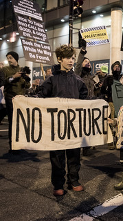 A Child with Witness Against Torture Protests Outside the Presidential Inauguration of Donald Trump