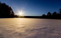 Sunflare Over A Frozen Lake (John Kocijanski) Tags: snow ice lake winter sun sunflare canon1022mmlens landscape