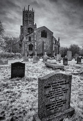 In the churchyard (David Feuerhelm) Tags: outdoors blackandwhite monochrome nikkor bw contrast church tower churchyard grave graveyard gravestone fothinghay wideangle infrared silverefex nikon d90 innamoramento