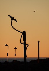 Artistic Bird on a Pole OR Irony (mikecogh) Tags: glenelg sunset silhouette publicart installation bird poles irony