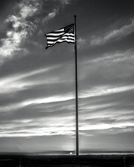 Symbol Of Freedom (http://fineartamerica.com/profiles/robert-bales.ht) Tags: blue red sky blackandwhite usa cloud sunlight white monochrome yellow horizontal america sunrise freedom flying photo democracy state symbol wind stripes flag country scenic americanflag pride pole idaho falling national american states independence patriotism waving sunrisesunset celebrate striped yuma fluttering haybales suset vibrantcolor unitesstates gemcounty robertbales