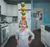 A Balanced Diet (Jason _Ogden) Tags: d90 portrait nikon balance apple orange stacked girl healthy foodpyramid balancing food flickrfriday green balanceddiet fruit vr18200mm kitchen