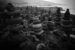 Tenerife, Spain - Stacked Stone (Regan Gilder) Tags: stackedstones stack stones stone rock rocks sculpture art style beach coast coastline tenerife spain canaryislands island islands canaries thecanaries theatlantic atlantic atlanticocean ocean puntabrava puertodelacruz canoneos5dmarkiii canon blackwhite bw
