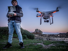 Kian Flies Drone at Porthellick (davidmcbridephotography) Tags: drone phantom dji aerial olympus loadedcamel islesofscilly cornwall mcbride apple flight cita newfoundland point scilly scillies united kingdom photography video evening rock formation sir cloudisley shovell hms association omd em10 night lights led leds red higher moors trail nature rosk granite looks like stmarys island skybus otter twin fly areal panoramic sensational news views scenic relic monument hostory heritage english trust visit seascape wasser family orange sea water landscape