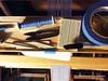 Weaving Supplies on the Nilus LeCleric Castle (eTextile Lounge) Tags: blue warp tools tape hook supplies bobbin weaving loom breadboard pickupsticks handwoven 2015 nilus darningneedle lynnebruning lecleric threadnipps