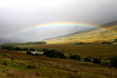 Rainbow near Tyndrum (Andrew Edkins) Tags: uk trees sun mountain canon river landscape geotagged photography scotland rainbow scenery hills tyndrum westhighlands
