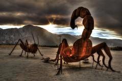 Scorpion vs. Cricket (Spebak) Tags: sunset sculpture sun canon fire sand desert steel smoke cricket scorpion forestfire canondslr solarflare anzaborregodesert desertmountains desertclouds canon30d spebak jsbcv