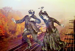 The Jealous Mistress Takes Action (joannmuench) Tags: collage train vintage outside antique surrealism duo pair group traintracks attack knife surreal running anger retro expressionism dada surrealistic storytelling cutandpaste retribution desertloca joannmuench fear19thcenturyclothes