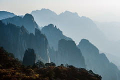Sunset in the Yellow Mountains (laskaproject) Tags: china blue sunset sun nature beautiful beauty yellow rock forest landscape view perspective scene formation wilderness distance depth huangshan