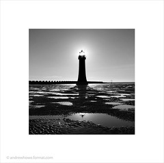 Perch Rock Lighthouse (Andrew James Howe) Tags: uk light blackandwhite lighthouse liverpool mono sand dusk mersey newbrighton merseyside andrewhowe perchrock perchrocklighthouse