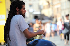 Hang on there (Elios.k) Tags: street camera travel people italy musician music man color colour travelling tourism horizontal canon hair beard outdoors person one long dof play hand drum bokeh many crowd earring july piercing depthoffield instrument pedestrians perform perugia hang rasta passerby umbria 2015 backgroundblur idiophone 5dmkii focusinforeground