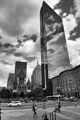 Copley Square, Boston Massachusetts (Images by Arden) Tags: city people urban bw usa cars blancoynegro monochrome boston architecture clouds skyscrapers noiretblanc massachusetts famous newengland highcontrast panasonic architect highrise trinitychurch crowds touristic copleysquare bostonskyline bostonist johnhancocktower downtownboston cityofboston imagesbyarden panasoniclumixdmclx7