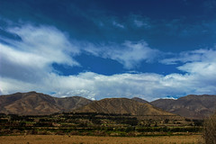 Clouds in the valley (christianhaward) Tags: valledelelqui valle valley sky bluesky cielo nubes clouds cerros mounts green verdes paisajes árboles trees