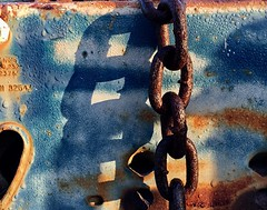 Chained (Beth Reynolds) Tags: blue rust rusty metal shadow light morning dawn dew water texture strong painterly