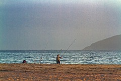 Morning Fishing (Sterling67) Tags: fisherman rods water fingal bay sand grainy mist island