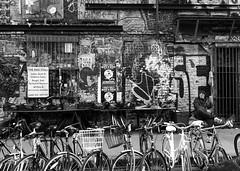 the bike stall (gregjack!) Tags: uk london shoreditch street streetphotography bikes bikestall man trader graffiti sony sonyrx10m3