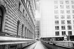 ...jump.betweenthetimes... (*ines_maria) Tags: vienna architecture building modern urban city urbanart panasonicdmcgx8 jump man person bw blackandwhite mono monochrome