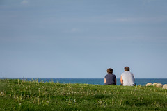 Time together (dharder9475) Tags: woman man grass rock couple sitting quiet candid lakemichigan together frombehind staring 2015 chicagoparkdistrict privpublic