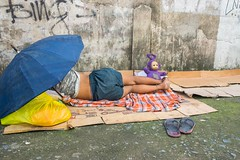 Street scene (Kuba Abramowicz) Tags: philippines cebu asia asian visayas central island islands umbrela teletubbies flip flops purple color colors colour colours yellow bag sleep sleeping nikon nikkor nikor 35mm homeless cardboard poor blanket d610 poverty street streets scene