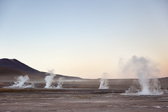 Geysers del Tatio (Voyages Lambert) Tags: chileanethnicity travel altiplano extremeterrain surreal beautyinnature condensation temperature atacamaregion atacamadesert volcaniclandscape dawn geyser fumes scenics heattemperature journey joy bizarre americanculture cultures nationallandmark famousplace south vacations nature outdoors chile theamericas sunrisedawn rockobject volcano andes mountain valley landscape sky steam fog smokephysicalstructure parkmanmadespace tatio chileanculture biologicalculture